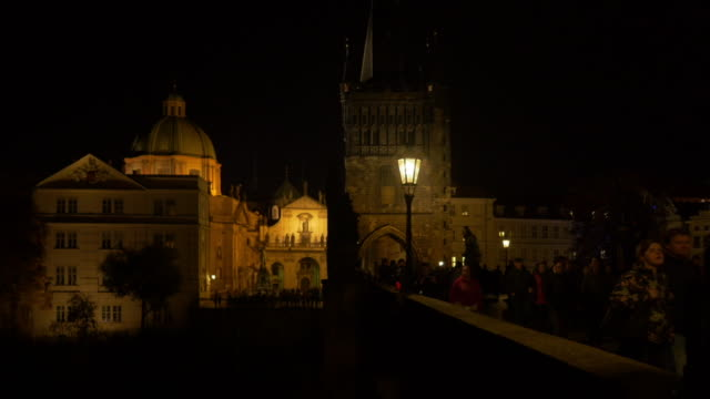 prague charles bridge and old town at night - old town bridge tower stock videos and b-roll footage