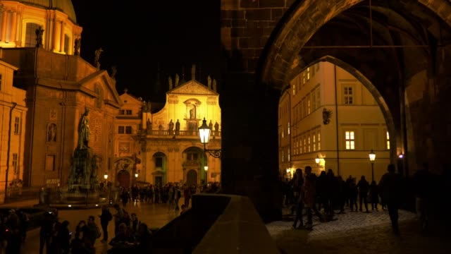 prague charles bridge and prag křižovnické náměstí at night - old town bridge tower stock videos and b-roll footage
