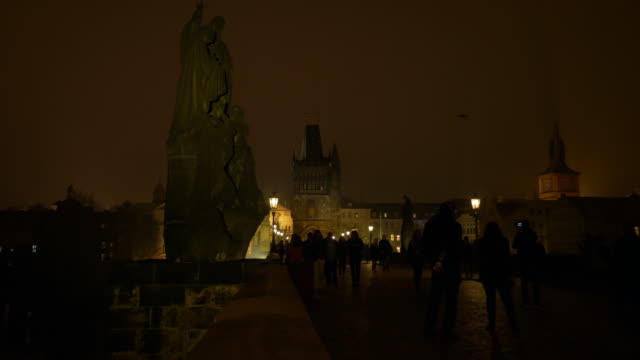 prague charles bridge at night - charles bridge stock videos and b-roll footage