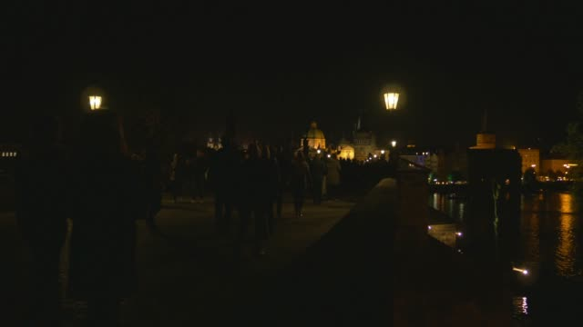 prague charles bridge at night - charles bridge stock videos & royalty-free footage