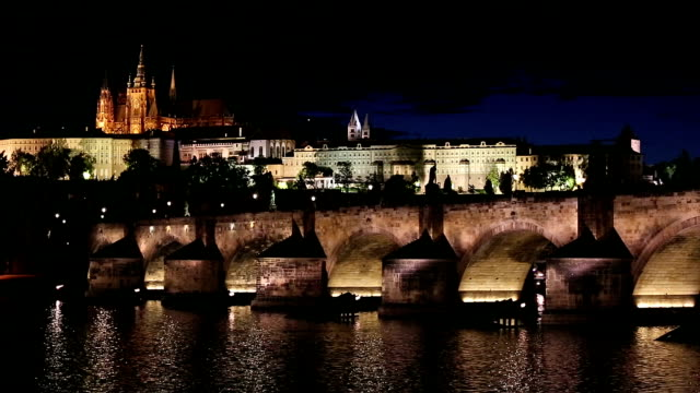 prague cityscape with vltava river czech republic night - mala strana stock videos and b-roll footage