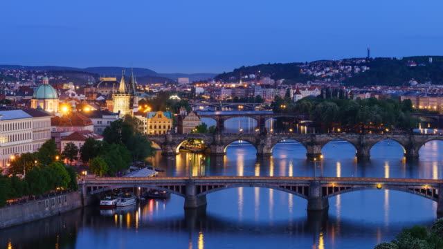 Prague day to night time lapse, high angle long shot of Old Town and bridges over Vlatava River