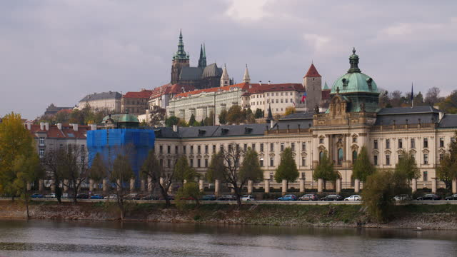 prague government office and hradcany castle at vltva river - wop productions stock-videos und b-roll-filmmaterial
