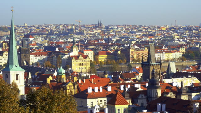 prague skyline with charles bridge and old town - prague bridge stock videos and b-roll footage