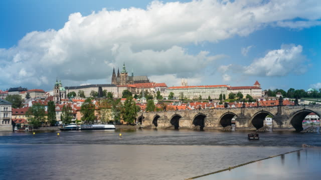 Prague skyline with St. Vitus Cathedral, Charles Bridge and the Castle District, time lapse