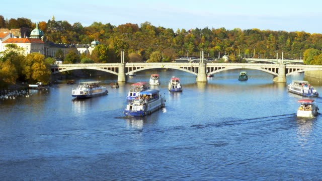 prague tourboats on vltava river - river vltava stock videos & royalty-free footage