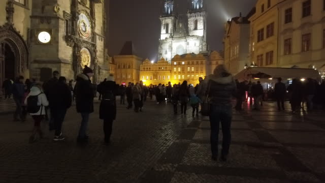 prague tourists walking in old town square at night - prague old town square stock videos & royalty-free footage