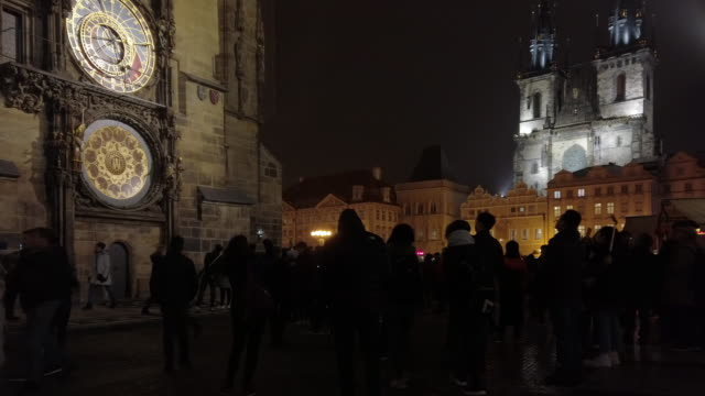 prague tourists watching the astronomical clock at night - walking point of view stock videos & royalty-free footage