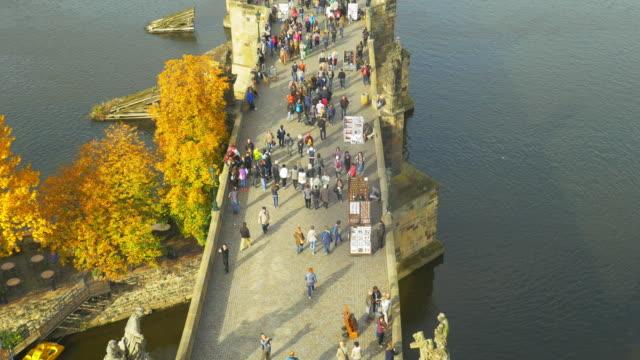 prague vltava river and charles bridge - praga video stock e b–roll