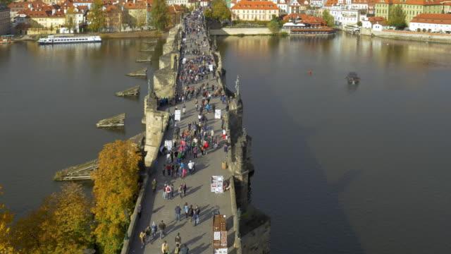 prague vltava river and charles bridge - river vltava stock videos & royalty-free footage
