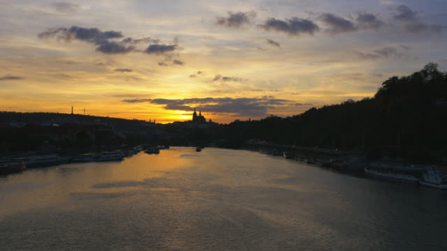 prague vltava river and hradcany castle hill at sunset - hradcany castle stock videos and b-roll footage