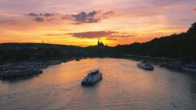 prague vltava river and hradcany hill at sunset - tourboat stock videos & royalty-free footage