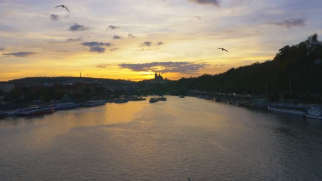prague vltava river and hradcany hill at sunset - river vltava stock videos & royalty-free footage