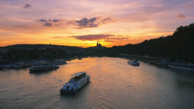 prague vltava river and hradcany hill at sunset - river vltava stock videos & royalty-free footage