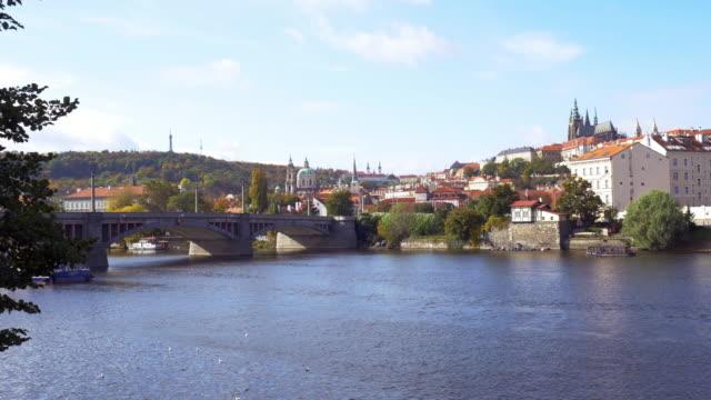 prague vltava river and hradcany hill - st nicholas's church prague stock videos and b-roll footage