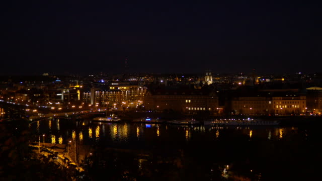 prague vltava river and old town at night - prague stock videos & royalty-free footage