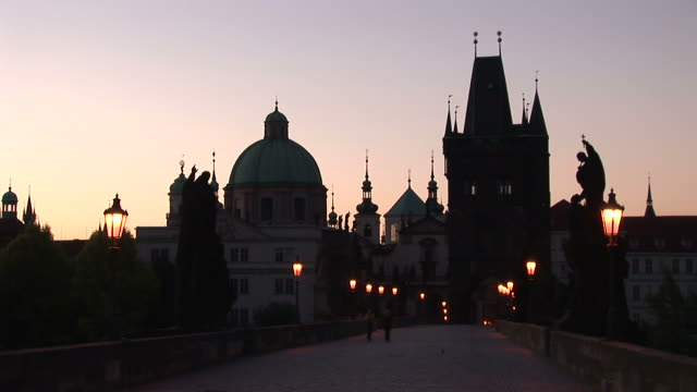 pragueold town bridge at magic hour in prague czech republic - st frantisek church stock videos and b-roll footage
