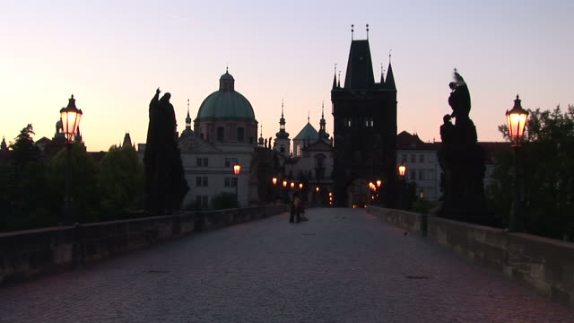 pragueold town bridge at magic hour in prague czech republic - 宗教施設点の映像素材/bロール