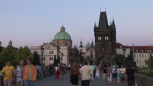 praguest. francis church and old town bridge tower at magic hour in prague czech republic - st frantisek church stock videos and b-roll footage