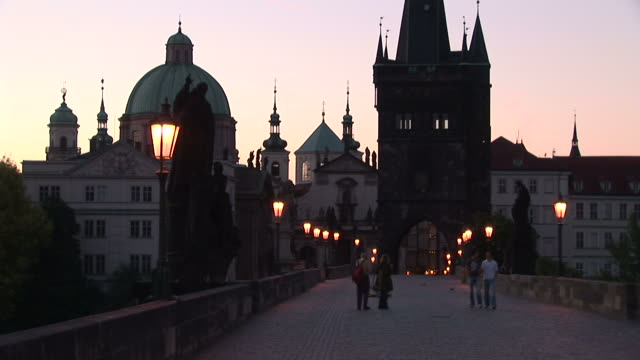 PragueSt. Francis Church and Old Town Bridge Tower at magic hour in Prague Czech Republic