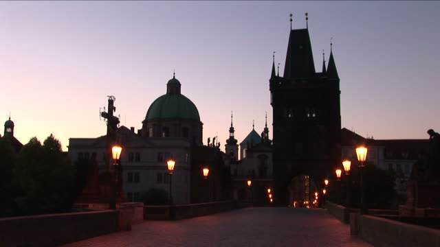 praguest. nicolas church at magic hour in prague czech republic - st frantisek church stock videos and b-roll footage
