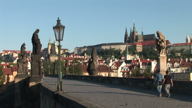 praguestatue monuments on old town bridge in prague czech republic - stare mesto stock videos & royalty-free footage