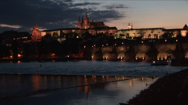 vidéos et rushes de pragueview of a clock tower and vltava river at night in prague czech republic - culture tchèque