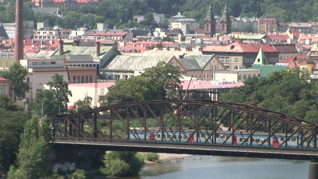 pragueview of a train crossing the bridge in prague czech republic - traditionally czech stock videos & royalty-free footage