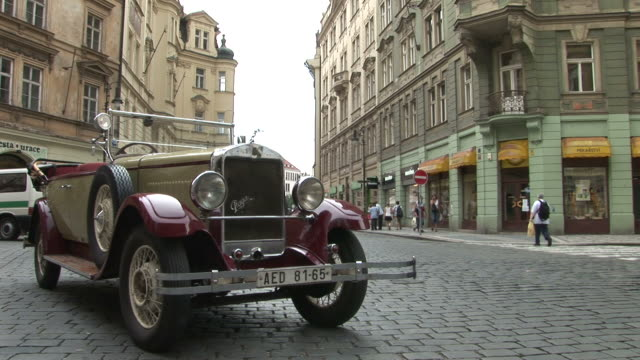 pragueview of a vintage car parked in the city street of prague czech republic - collector's car stock videos & royalty-free footage