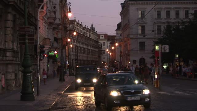 pragueview of city street at night in prague czech republic - baumaterial stock-videos und b-roll-filmmaterial