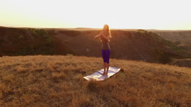 prairie yoga at sunrise - exercise equipment stock videos & royalty-free footage