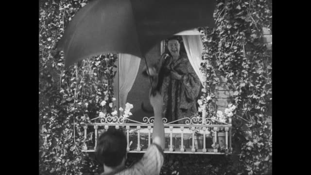 stockvideo's en b-roll-footage met 1927 a prank turns man (buster keaton) into a peeping tom - communication problems