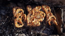 Prawn baking and roasting on barbecue grill. Shrimp grilled over charcoal. 4K