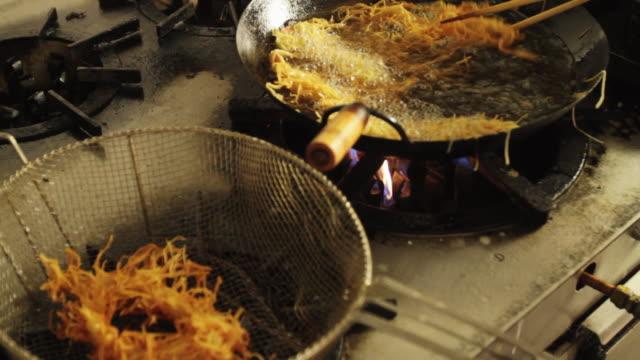 MS R/F Prawn dish preparation at a kitchen deep frying prawn tempura / Sao Paulo, Brazil