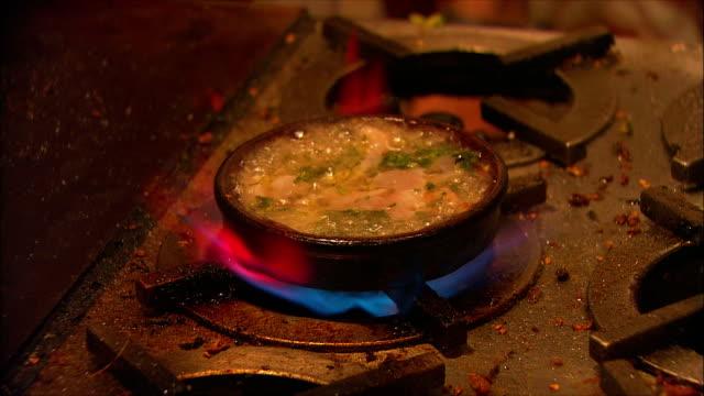 montage prawns and tapas in preparation, madrid, spain - tapas stock videos & royalty-free footage