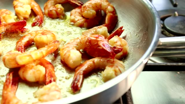 prawns being fried in a pan - savory food stock videos and b-roll footage