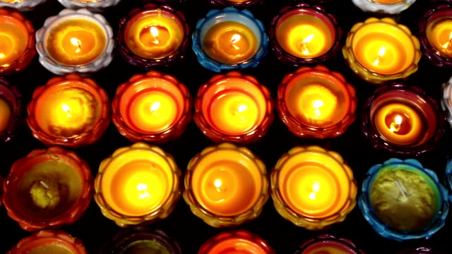 pray candle - oil lamp stock videos & royalty-free footage