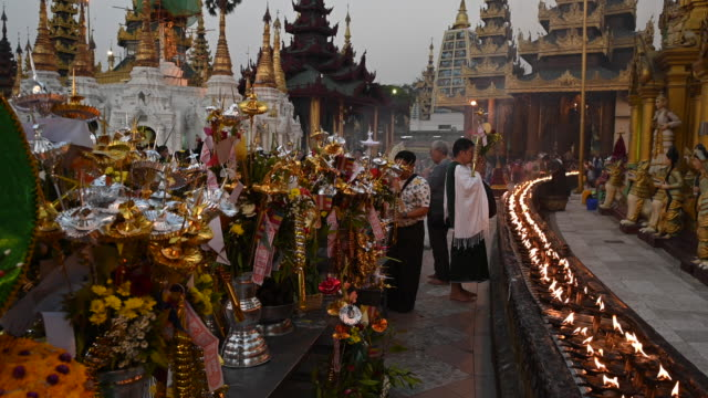 prayer and offerings in the shwedagon pagoda, yangon, myanmar - pagoda stock videos & royalty-free footage