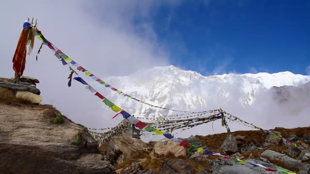 Prayer flags and Annapurna mountain range background