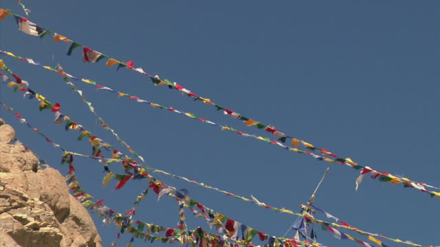 zo, ms, la, prayer flags and leh palace in mountain landscape, leh, ladakh, jammu and kashmir, india - 17th century style stock videos & royalty-free footage