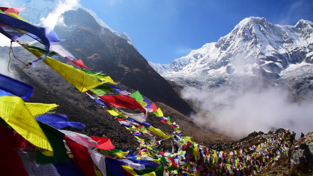 prayer flags and mt. annapurna i background - nepal stock videos & royalty-free footage