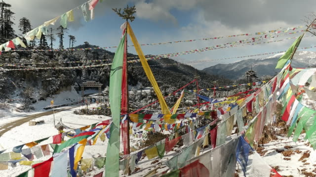 prayer flags at the thrumshingla pass in bhutan - bhutan stock videos & royalty-free footage