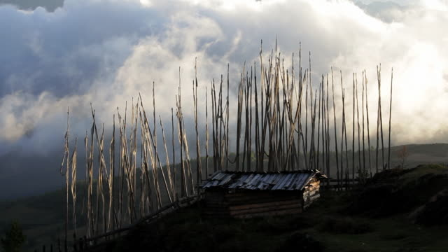 prayer flags blowing in the wind high in the foothills, bumthang valley, bhutan, asia - foothills stock videos & royalty-free footage