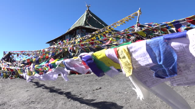 prayer flags floating in the wind, leh ladakh, north india - nepal stock videos & royalty-free footage