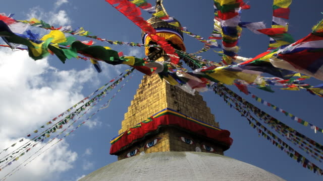 prayer flags flying from the  boudhanath stupa, a place of holy worship, kathmandu, nepal, asia - mandala stock videos & royalty-free footage