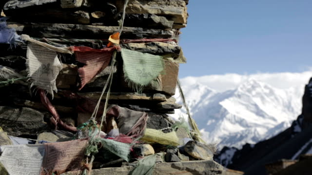 prayer flags on a mountain summit, nepal - asian tribal culture stock videos and b-roll footage