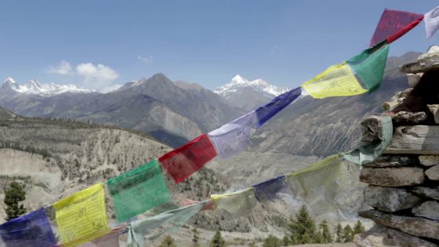 prayer flags on a mountain summit, nepal - annapurna range stock videos and b-roll footage