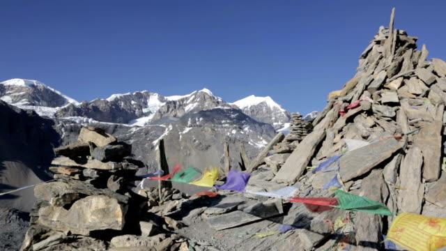 stockvideo's en b-roll-footage met prayer flags on a mountain summit, nepal - annapurna range