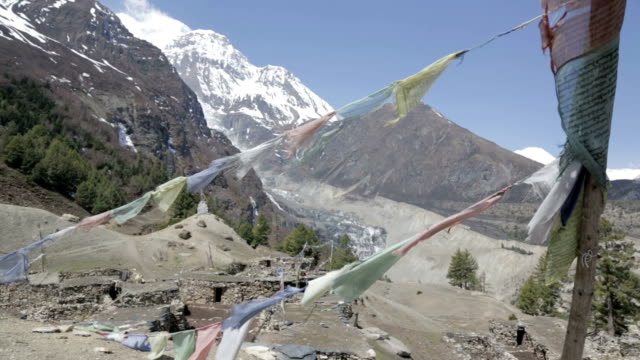 prayer flags on a mountain summit, nepal - country road stock videos & royalty-free footage