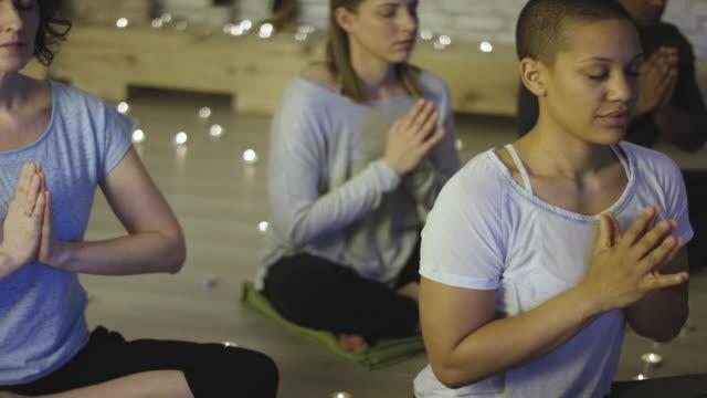 prayer pose meditation - yoga studio stock videos & royalty-free footage